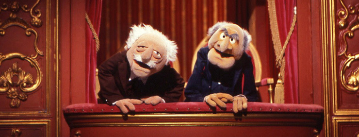 Muppet Show's Statler and Waldorf looking down from their balcony